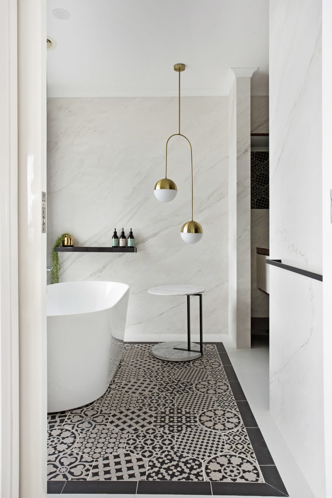 Example of a trendy white tile multicolored floor freestanding bathtub design in Geelong with white walls