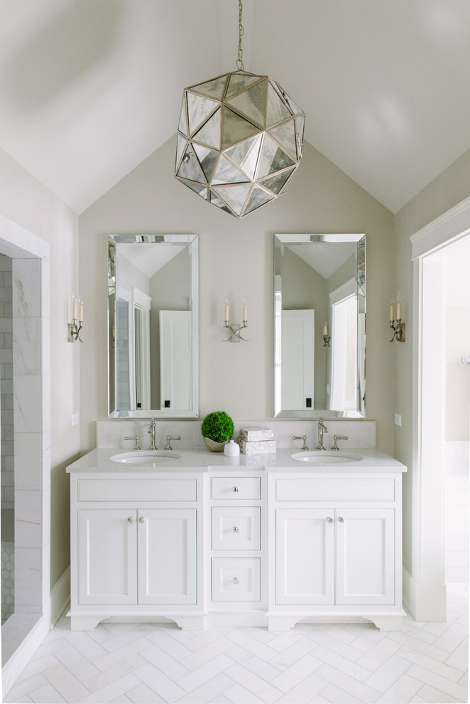 Inspiration for a transitional master marble floor alcove shower remodel in Chicago with recessed-panel cabinets, white cabinets, beige walls and an undermount sink