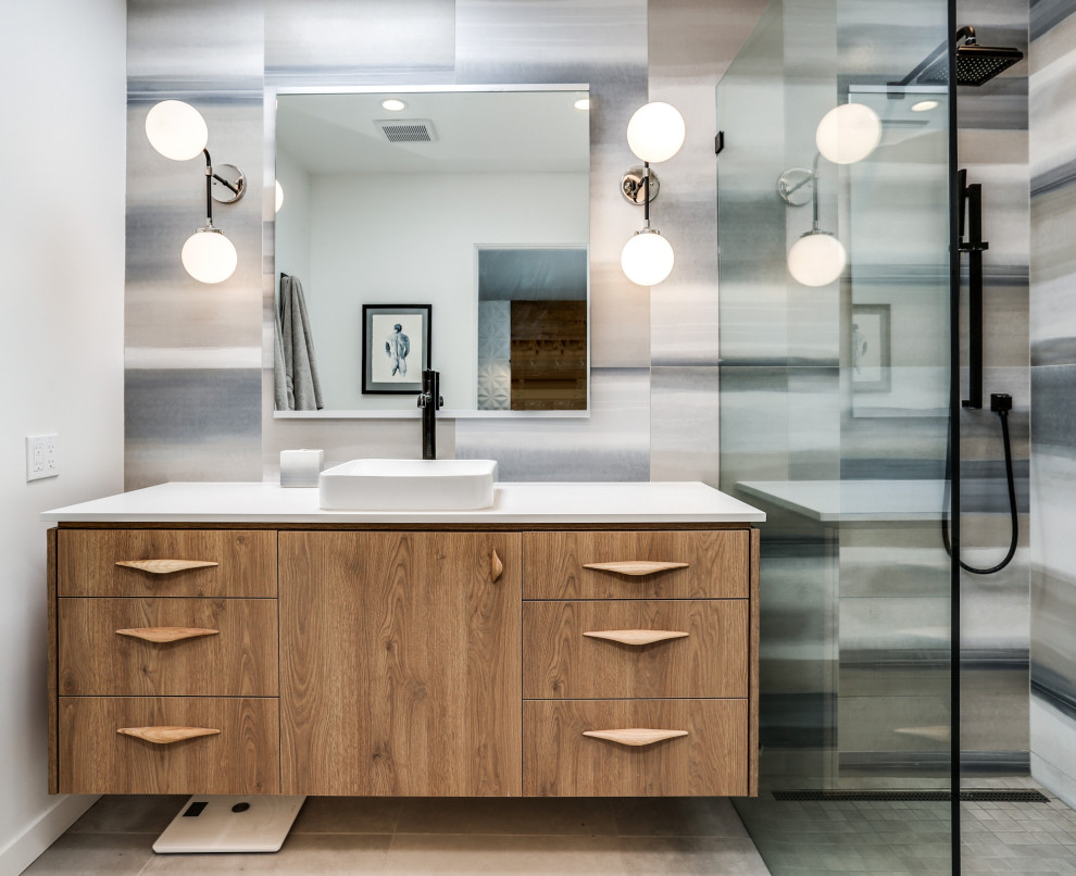 Bathroom - mid-sized 1950s 3/4 multicolored tile beige floor and single-sink bathroom idea in Other with flat-panel cabinets, medium tone wood cabinets, gray walls, a vessel sink, white countertops and a floating vanity