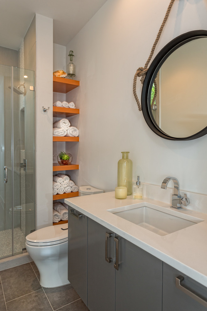 Inspiration for a small contemporary bathroom remodel in Austin with gray cabinets