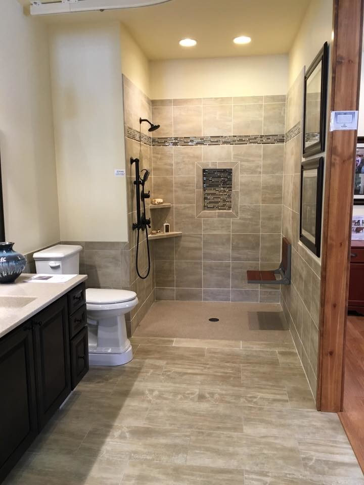 Mid-sized trendy gray tile and porcelain tile porcelain tile and gray floor open shower photo in Denver with recessed-panel cabinets, black cabinets, a two-piece toilet, beige walls, an integrated sink, quartz countertops and gray countertops