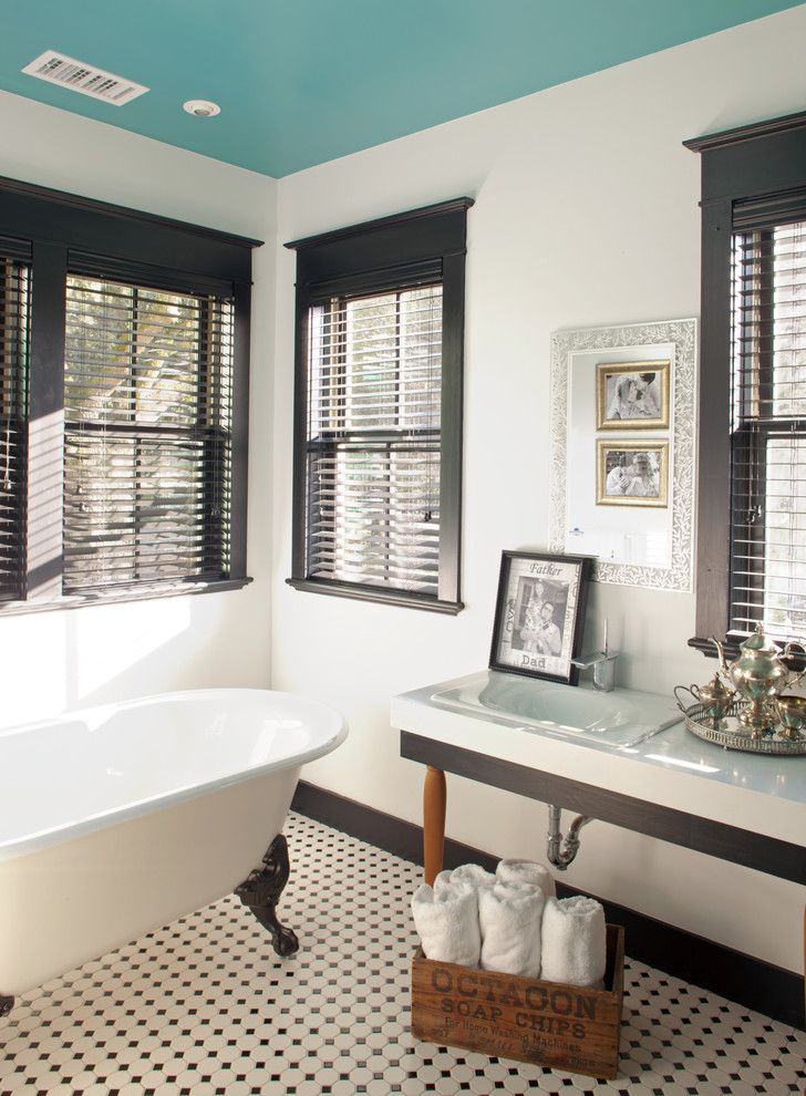 Ornate black and white tile multicolored floor claw-foot bathtub photo in Jacksonville with an integrated sink