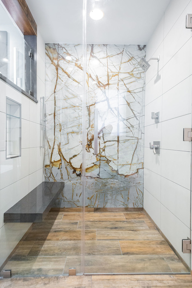 Example of a mid-sized minimalist porcelain tile porcelain tile and brown floor bathroom design in Other with flat-panel cabinets, gray cabinets, a two-piece toilet, white walls, an undermount sink, quartzite countertops and a hinged shower door