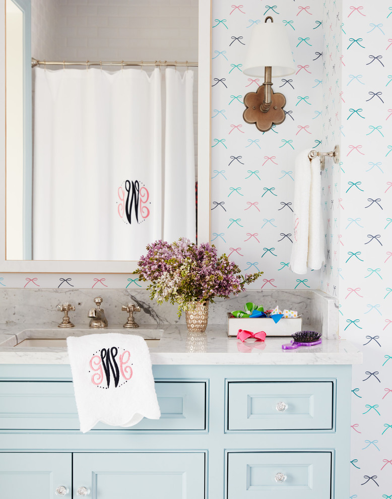 Example of a mid-sized beach style kids' bathroom design in Jacksonville with flat-panel cabinets, blue cabinets, multicolored walls, an undermount sink and soapstone countertops