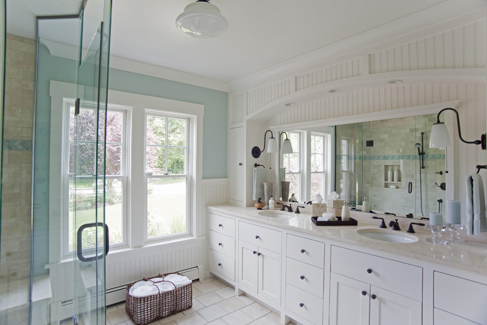 Example of a beach style beige tile and stone tile bathroom design in Providence with an undermount sink, shaker cabinets and white cabinets