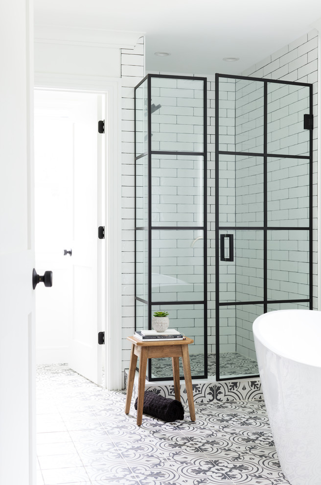 Example of a mid-sized farmhouse master white tile and ceramic tile porcelain tile and white floor bathroom design in New York with white walls and a hinged shower door