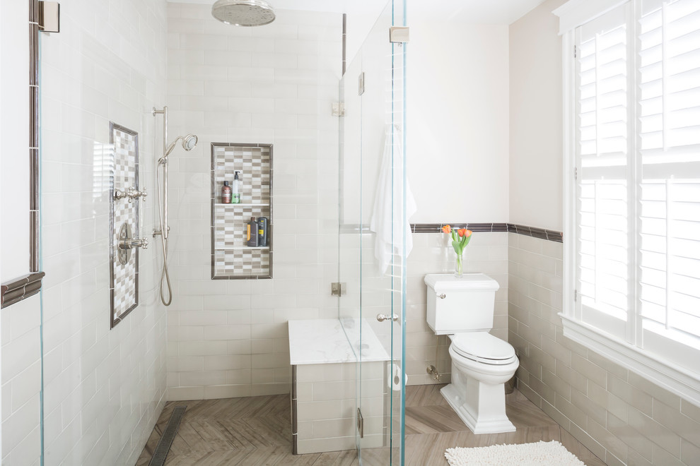 Elegant white tile and subway tile corner shower photo in New York with a two-piece toilet