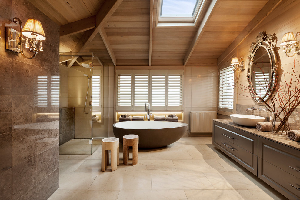 Design ideas for a large classic ensuite bathroom in Melbourne with a vessel sink, raised-panel cabinets, a freestanding bath, a built-in shower and beige tiles.