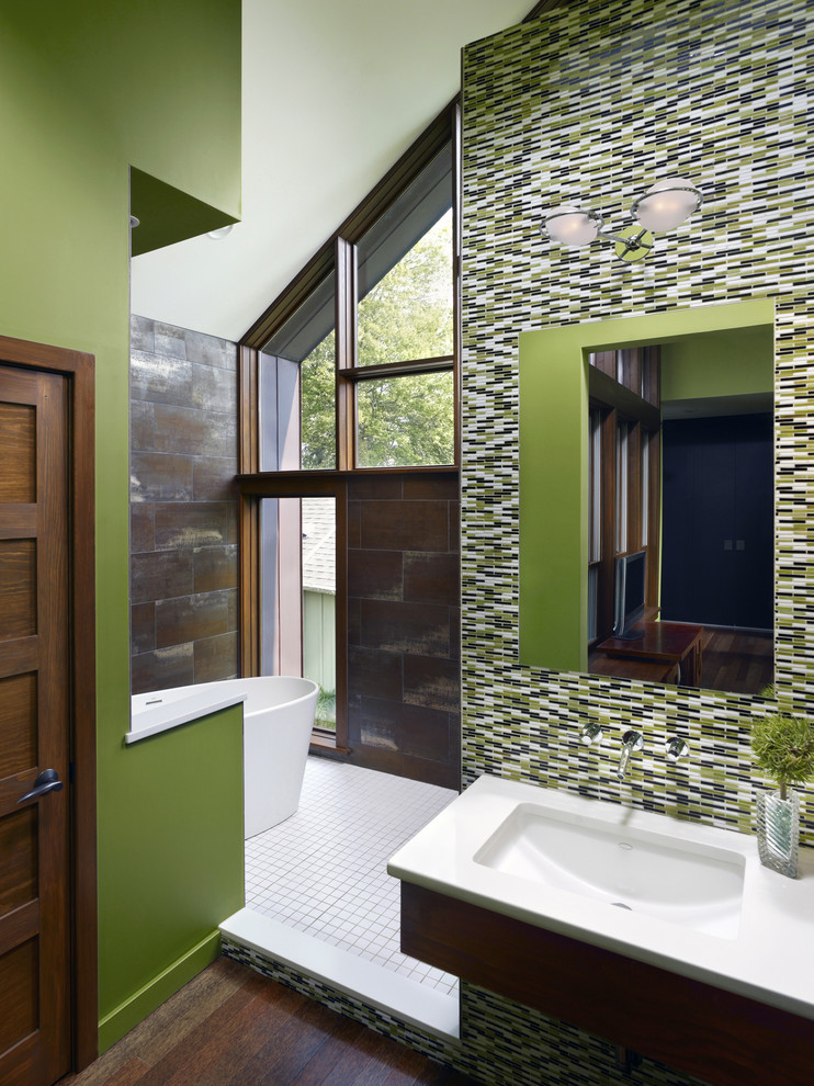 Cottage master multicolored tile and glass tile dark wood floor bathroom photo in Philadelphia with an undermount sink, flat-panel cabinets, medium tone wood cabinets, green walls and quartz countertops