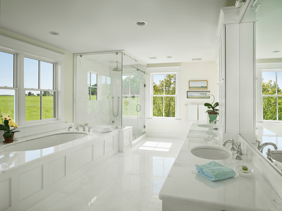 Corner shower - country white tile white floor corner shower idea in New York with an undermount sink, an undermount tub and white countertops