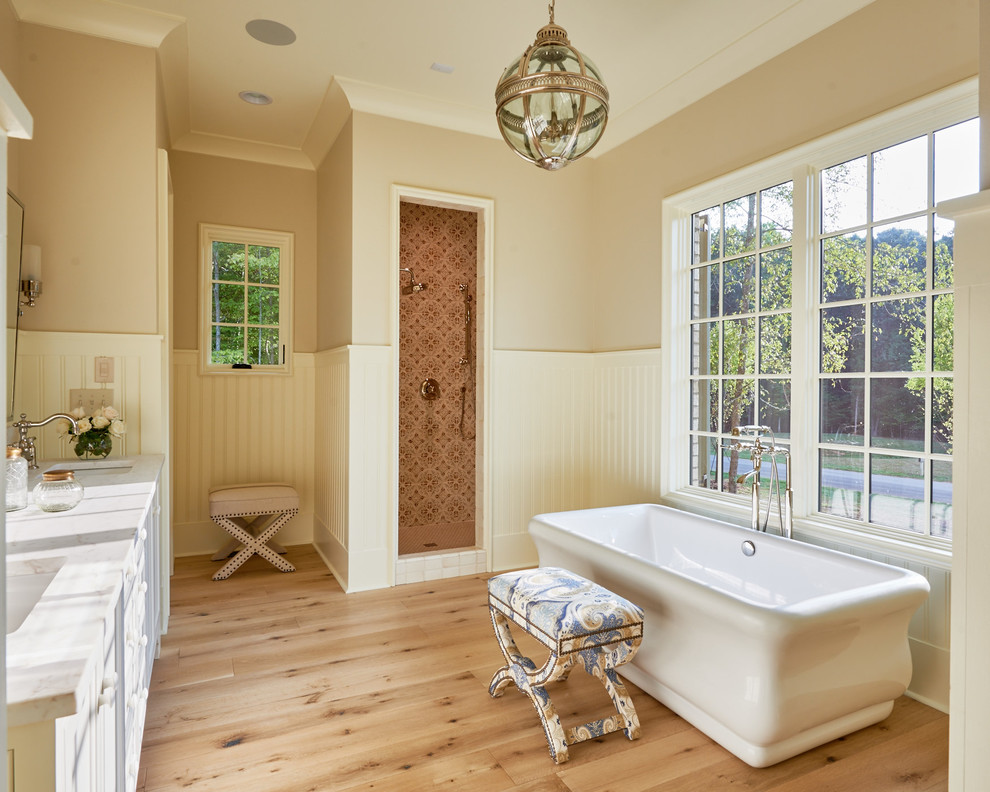 Bathroom - large cottage master light wood floor bathroom idea in Charlotte with an undermount sink and white cabinets