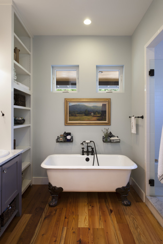 Inspiration for a cottage claw-foot bathtub remodel in Austin
