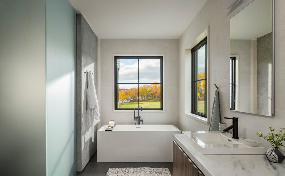 Example of a large cottage master white tile and porcelain tile porcelain tile and gray floor bathroom design in Burlington with flat-panel cabinets, dark wood cabinets, a vessel sink, marble countertops, white countertops and beige walls
