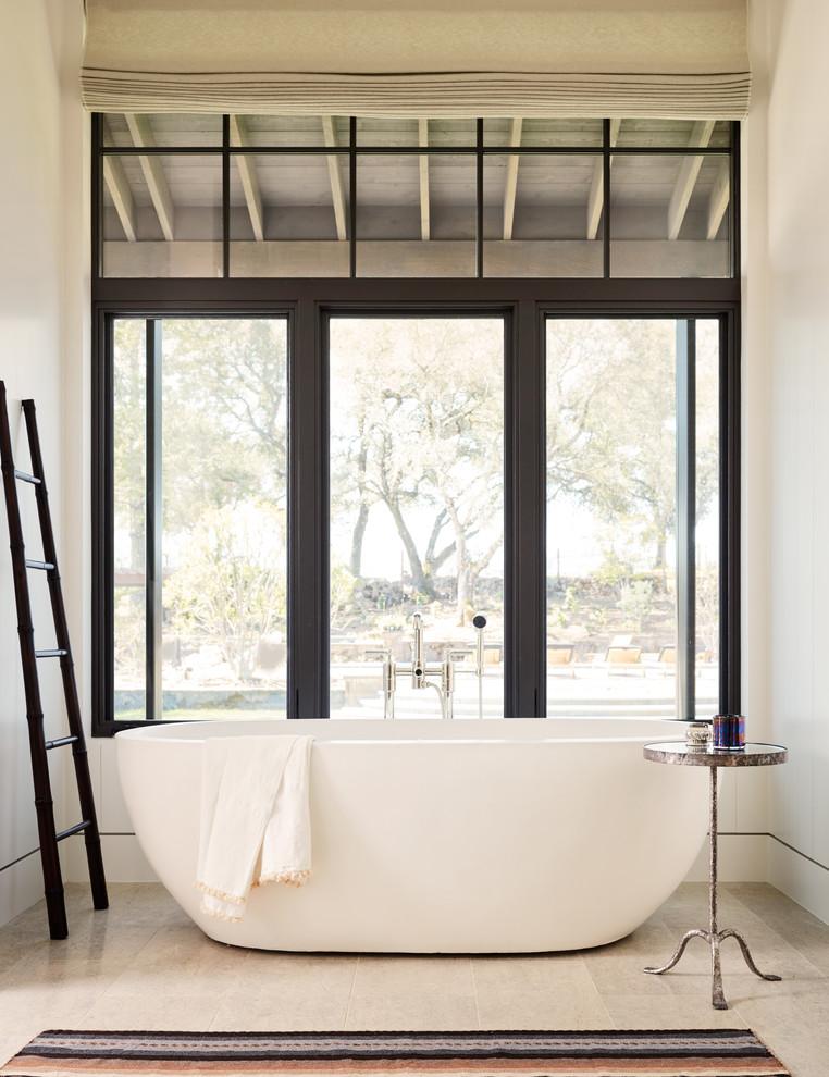 Cottage master beige floor freestanding bathtub photo in San Francisco with white walls