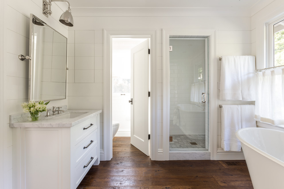 Alcove shower - mid-sized farmhouse master white tile and subway tile dark wood floor alcove shower idea in San Francisco with an undermount sink, shaker cabinets, white cabinets and white walls