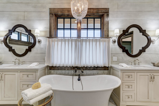 Farmhouse master freestanding bathtub photo in Oklahoma City with beaded inset cabinets, beige cabinets, gray walls and an undermount sink