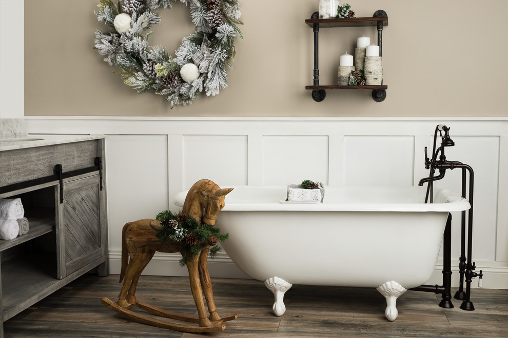 Claw-foot bathtub - mid-sized cottage master claw-foot bathtub idea in Other with furniture-like cabinets, gray cabinets, beige walls, an integrated sink, granite countertops and white countertops