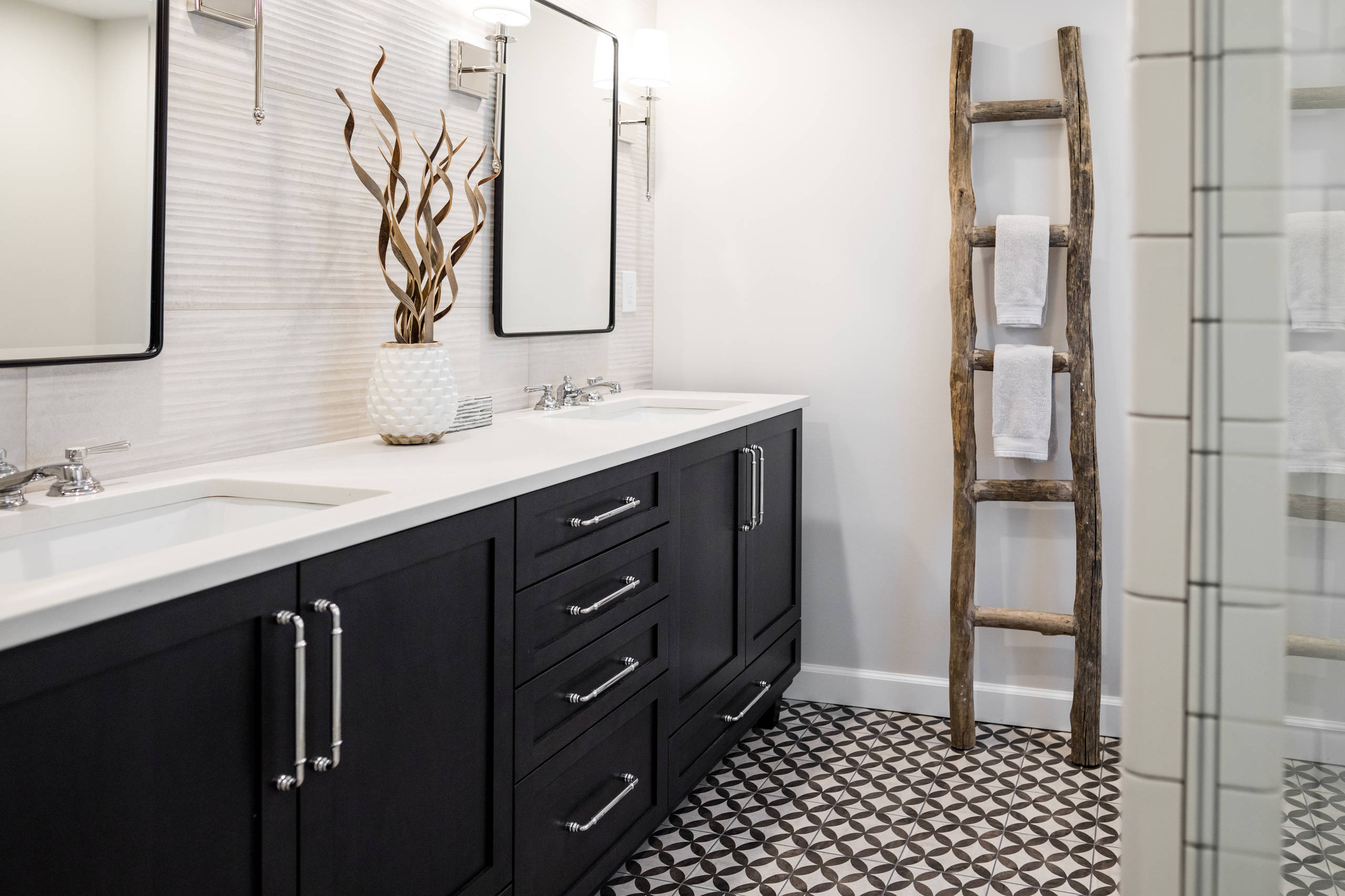 Mid-sized country master white tile and porcelain tile porcelain tile and multicolored floor corner shower photo in Detroit with shaker cabinets, black cabinets, a two-piece toilet, gray walls, an und