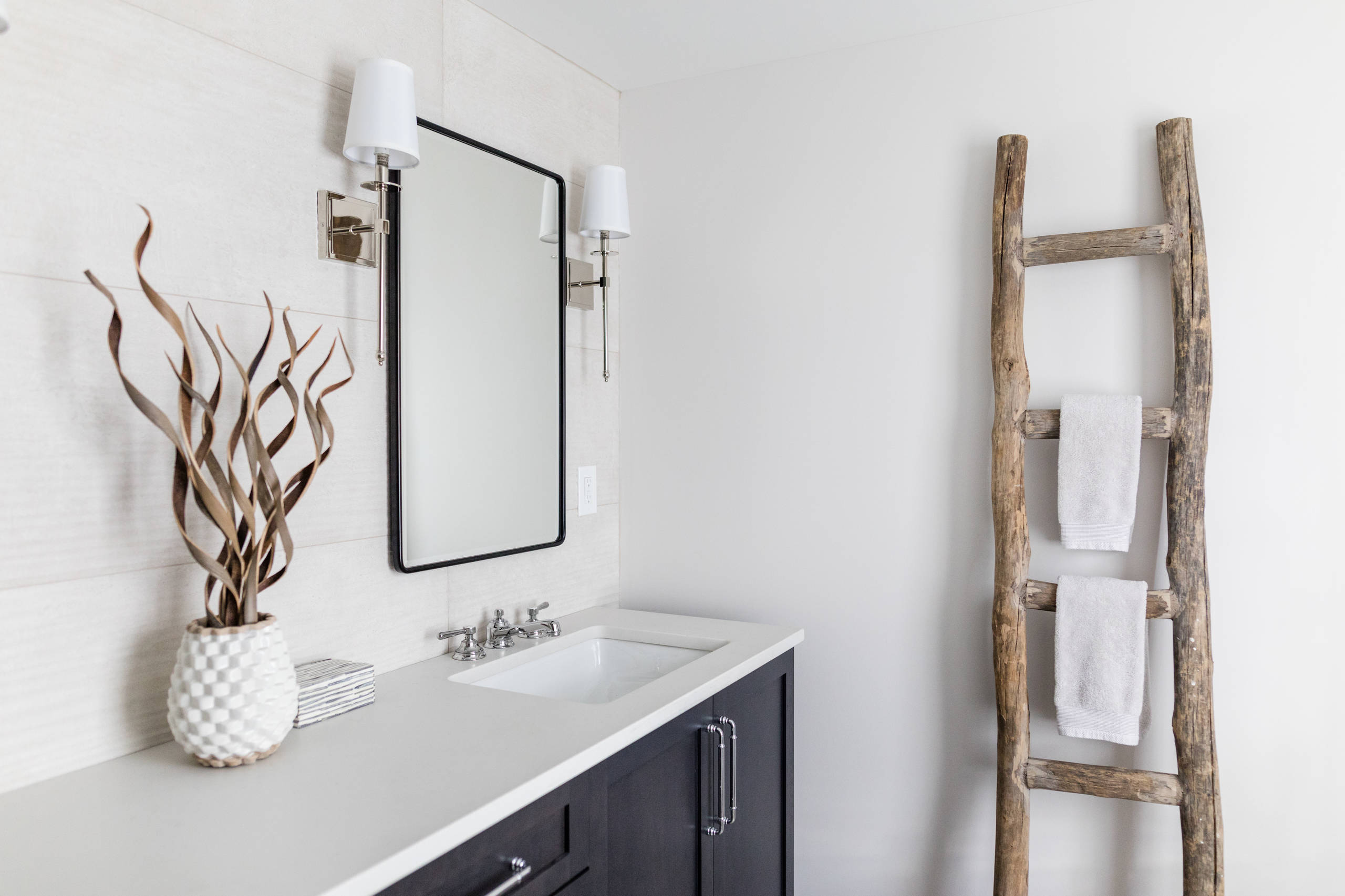 Example of a mid-sized cottage master white tile and porcelain tile porcelain tile and multicolored floor corner shower design in Detroit with shaker cabinets, black cabinets, a two-piece toilet, gray