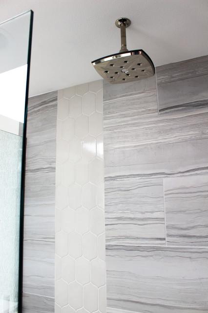 Example of a trendy gray tile doorless shower design in Seattle