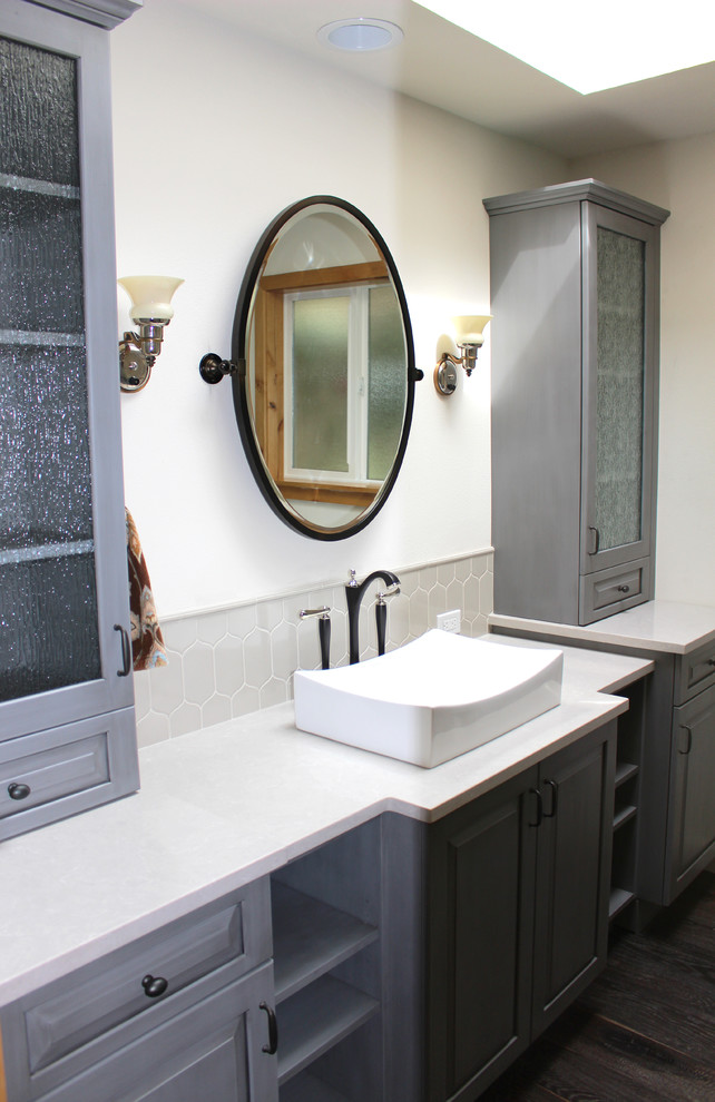 Bathroom - large transitional master gray tile and ceramic tile dark wood floor bathroom idea in Seattle with a trough sink, raised-panel cabinets, gray cabinets, quartz countertops, white walls and white countertops