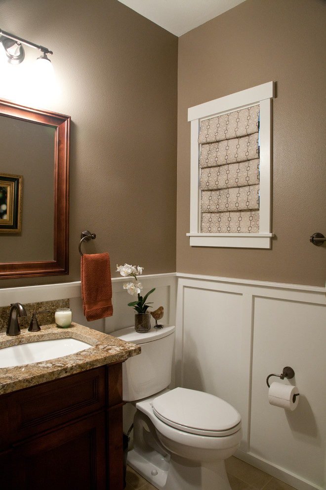 Bathroom - small traditional 3/4 ceramic tile bathroom idea in Seattle with an undermount sink, dark wood cabinets, granite countertops, a two-piece toilet, brown walls, furniture-like cabinets and brown countertops