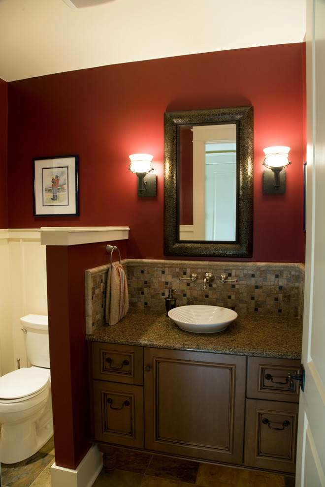 Example of a mid-sized classic 3/4 multicolored tile and mosaic tile bathroom design in Seattle with a vessel sink, beaded inset cabinets, dark wood cabinets, granite countertops, a two-piece toilet and red walls