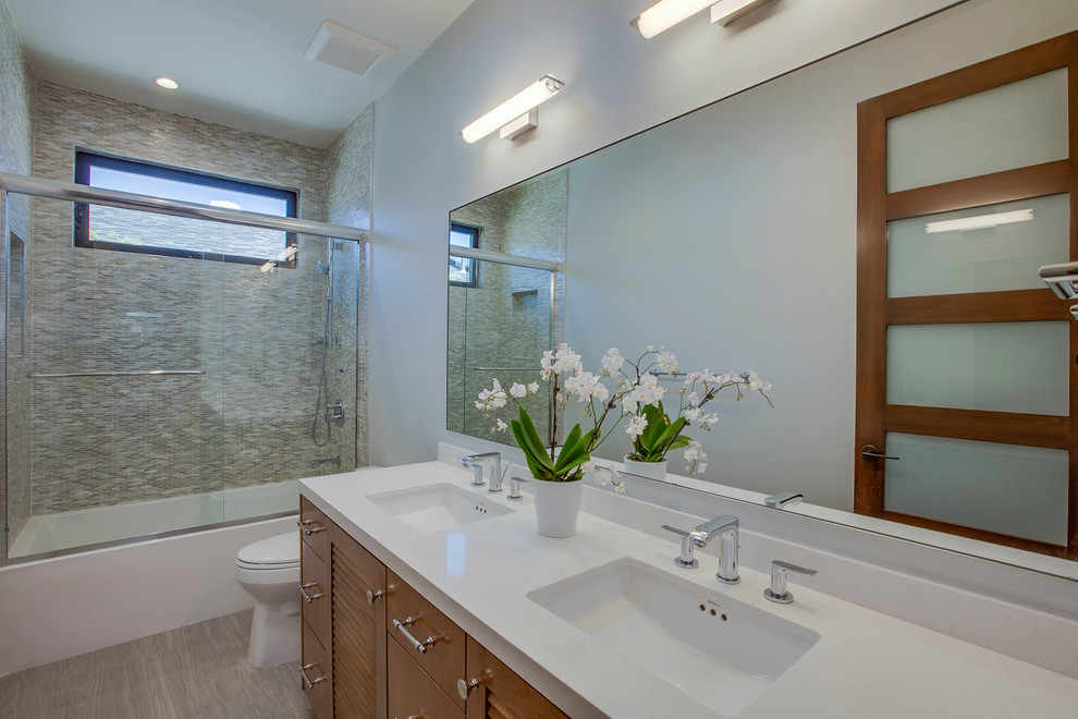 Example of a mid-sized trendy 3/4 multicolored tile and matchstick tile vinyl floor bathroom design in Los Angeles with shaker cabinets, dark wood cabinets, beige walls, an undermount sink and quartz countertops