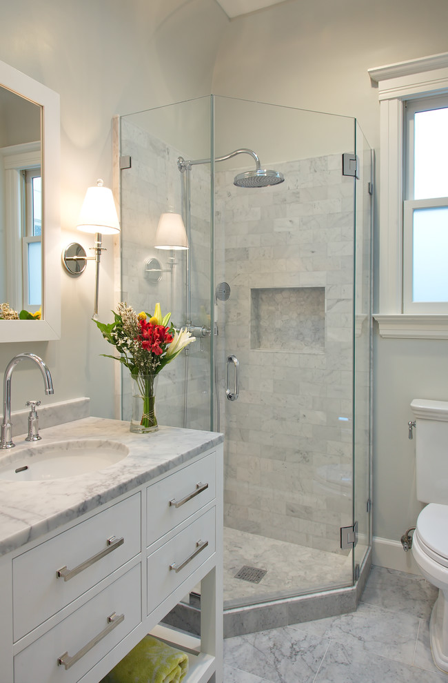 Corner shower - small transitional gray tile and stone tile marble floor corner shower idea in San Francisco with an undermount sink, flat-panel cabinets, white cabinets, marble countertops and white walls