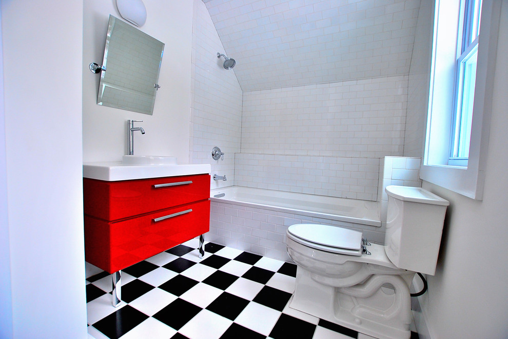 Bathroom - traditional white tile and subway tile multicolored floor bathroom idea in New York with an integrated sink, flat-panel cabinets and red cabinets