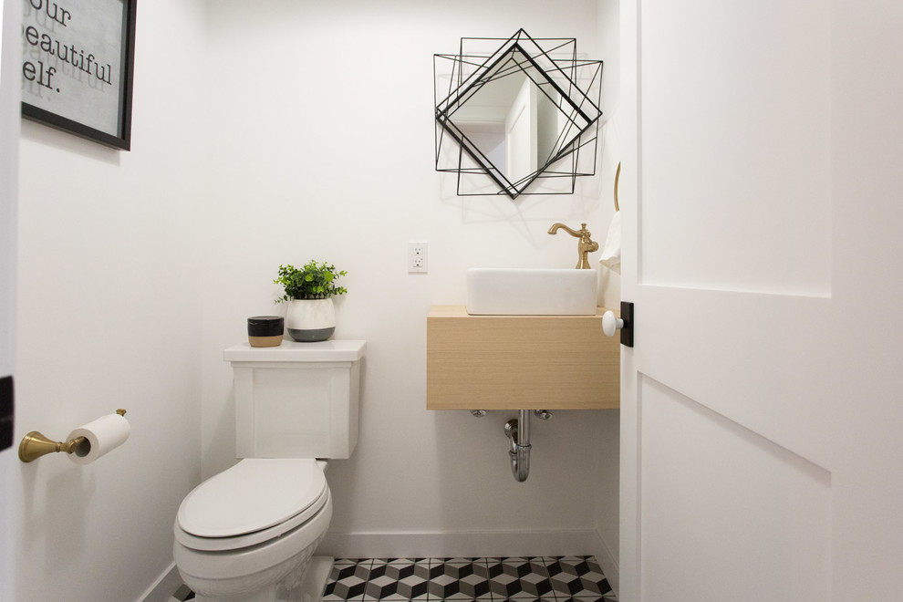 Example of a farmhouse 3/4 white tile alcove bathtub design in Los Angeles with shaker cabinets, white cabinets and white walls