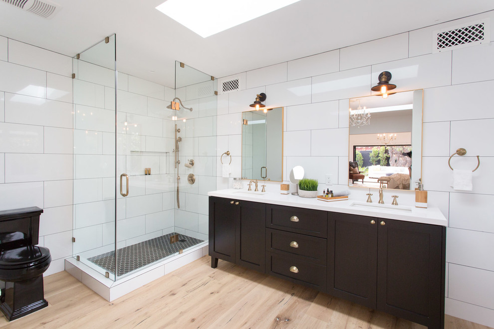 Farmhouse master white tile claw-foot bathtub photo in Los Angeles with shaker cabinets and black cabinets