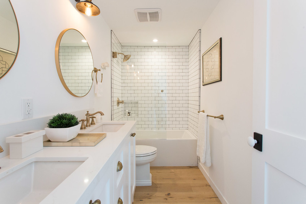 Example of a cottage kids' white tile alcove bathtub design in Los Angeles with shaker cabinets, white cabinets and white walls