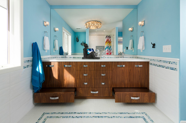 Inspiration for a mid-sized contemporary kids' white tile and ceramic tile ceramic floor bathroom remodel in Minneapolis with an undermount sink, flat-panel cabinets, medium tone wood cabinets, engineered quartz countertops, a one-piece toilet and blue walls