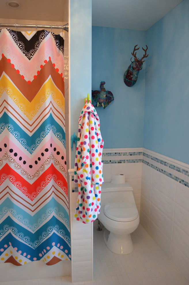 Inspiration for a mid-sized contemporary kids' white tile and ceramic tile ceramic tile bathroom remodel in Minneapolis with an undermount sink, flat-panel cabinets, medium tone wood cabinets, quartz countertops, a one-piece toilet and blue walls