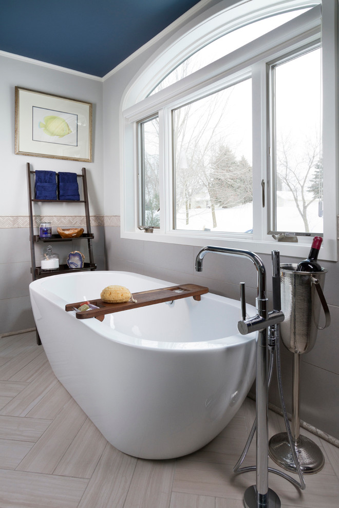 Inspiration for a contemporary master gray tile and porcelain tile ceramic tile bathroom remodel in Minneapolis with an undermount sink, flat-panel cabinets, medium tone wood cabinets, onyx countertops, a one-piece toilet and gray walls