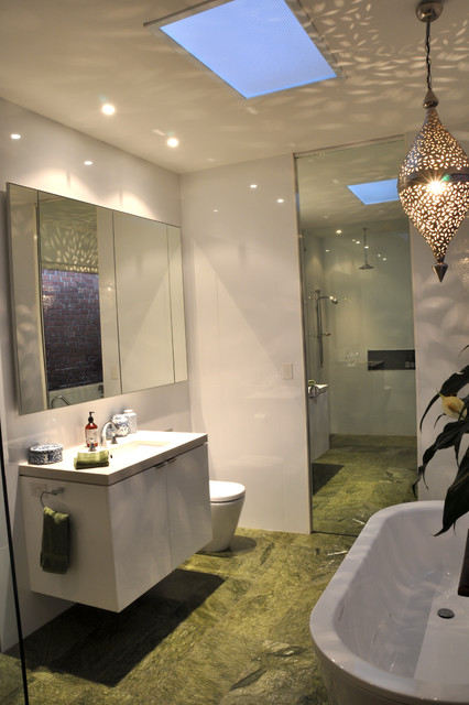 Inspiration for a modern master white tile and porcelain tile marble floor and green floor bathroom remodel in Geelong with flat-panel cabinets, white cabinets, a one-piece toilet, white walls and an undermount sink