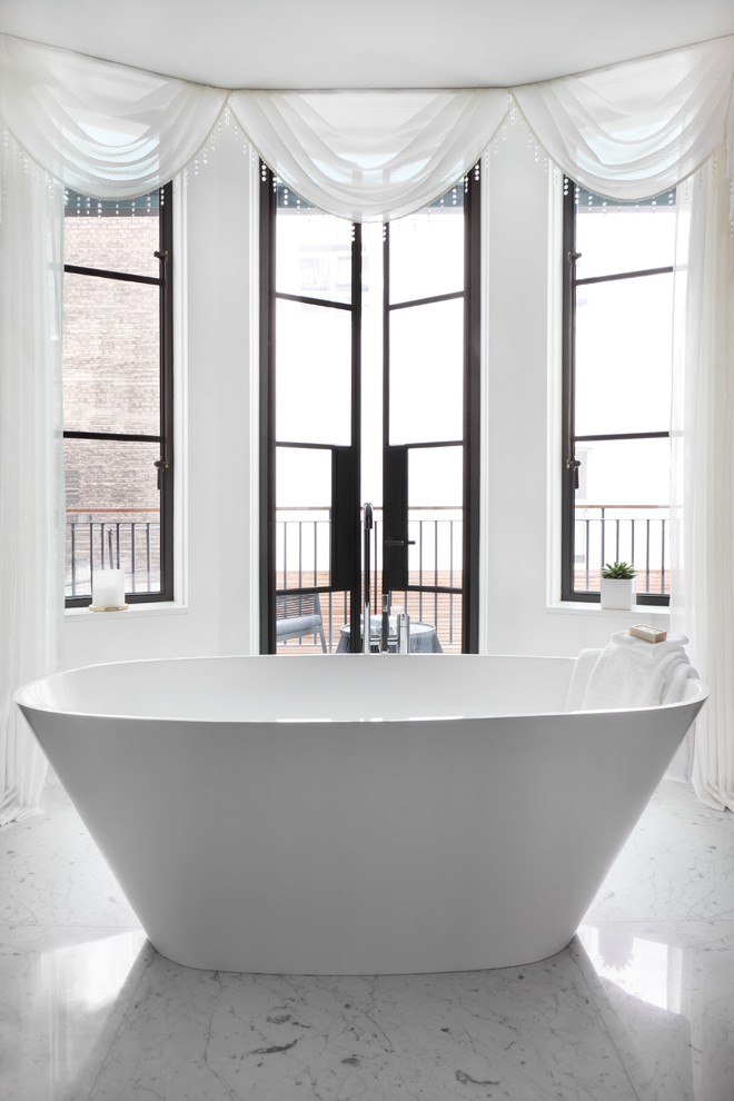 Design ideas for a contemporary bathroom in London with a freestanding bath.