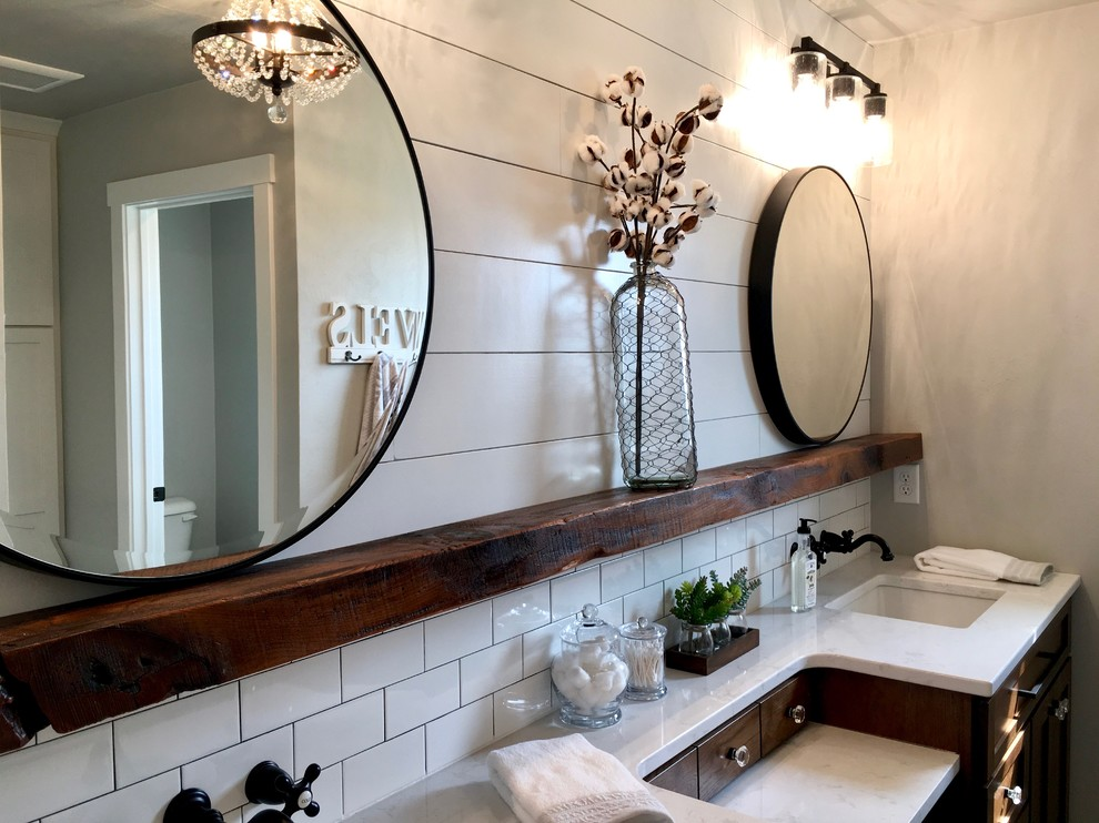Alcove shower - mid-sized farmhouse master ceramic tile and black floor alcove shower idea in Other with furniture-like cabinets, dark wood cabinets, a one-piece toilet, gray walls, a drop-in sink, marble countertops and a hinged shower door