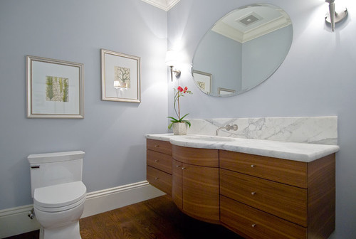 floating curved vanity with stained horizontal grain beech, marble counters contemporary bathroom