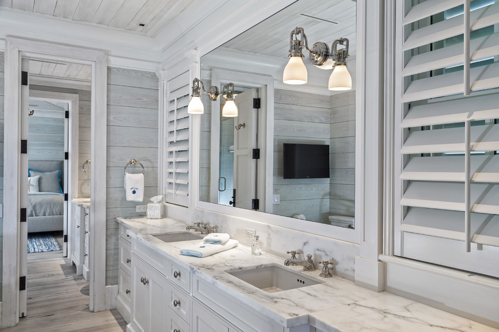 Beach style bathroom photo in Miami with marble countertops