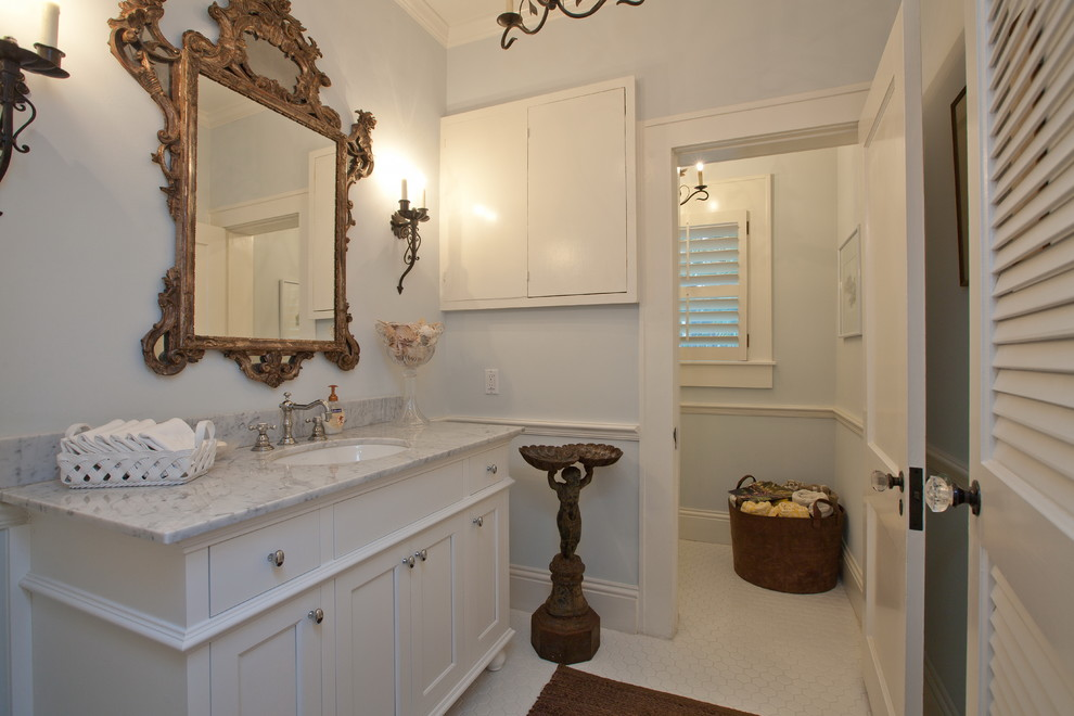 Inspiration for a mediterranean white tile bathroom remodel in Tampa with an undermount sink, shaker cabinets and white cabinets