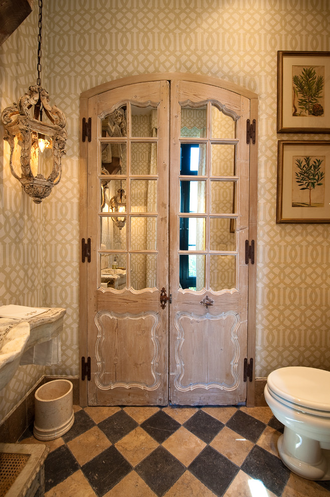 Example of a tuscan beige tile bathroom design in Charleston
