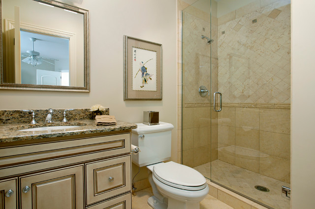 Example of a classic yellow tile and stone tile bathroom design in Denver with raised-panel cabinets, beige cabinets, marble countertops, a two-piece toilet and beige walls