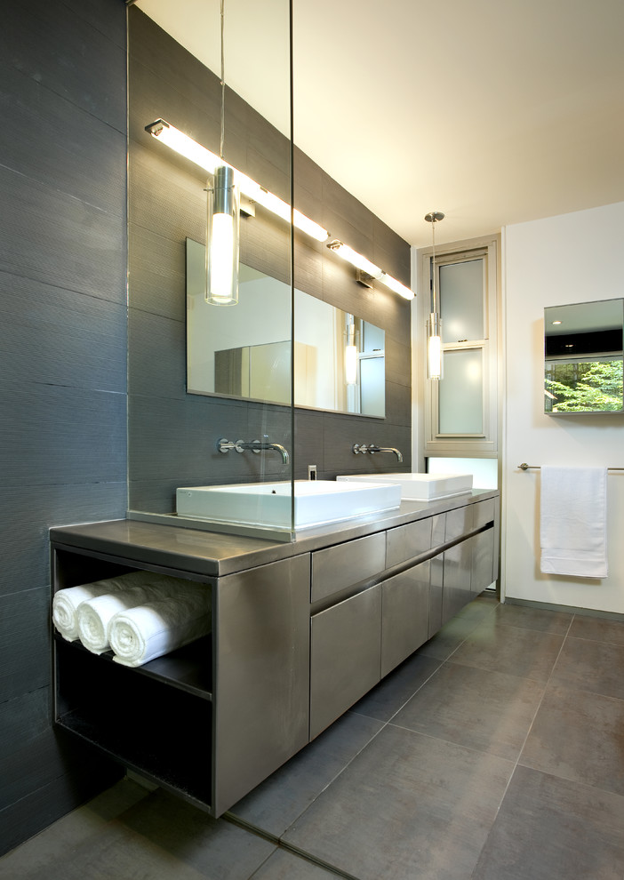 Trendy bathroom photo in DC Metro with a vessel sink and gray cabinets