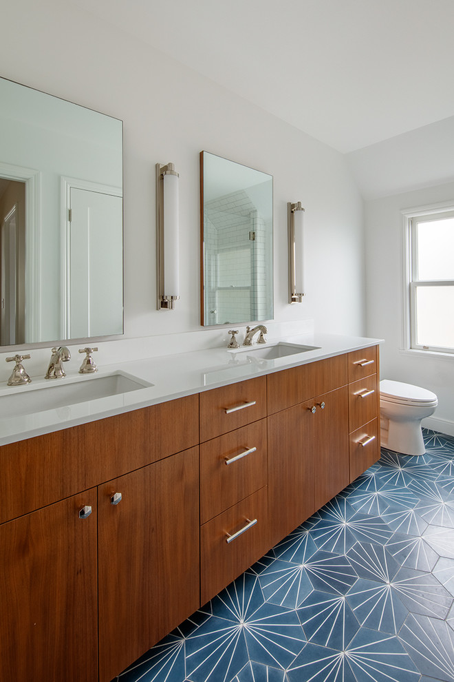 Inspiration for a small contemporary master white tile and ceramic tile cement tile floor and blue floor alcove shower remodel in San Francisco with flat-panel cabinets, dark wood cabinets, a one-piece toilet, white walls, an undermount sink, quartz countertops and a hinged shower door
