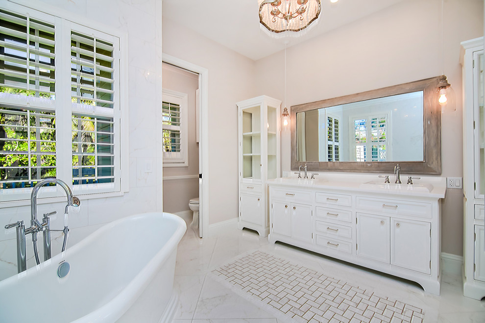 Bathroom - mid-sized transitional master white tile and porcelain tile porcelain floor and white floor bathroom idea in Miami with beaded inset cabinets, a two-piece toilet, gray walls, a drop-in sink, engineered quartz countertops and white cabinets