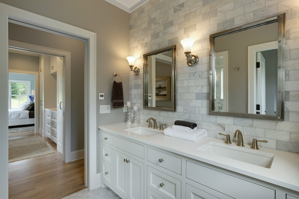 Mid-sized cottage master multicolored tile and stone tile marble floor alcove shower photo in Minneapolis with white cabinets, a two-piece toilet, beaded inset cabinets, gray walls, an undermount sink, quartz countertops and white countertops