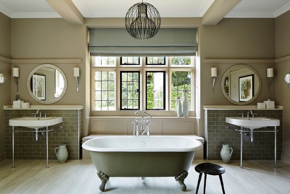 Mid-sized elegant master gray tile and subway tile light wood floor and beige floor bathroom photo in London with beige walls and a console sink