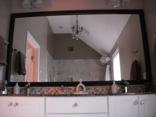 framed vanity mirror traditional bathroom